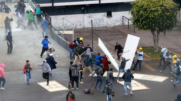 Soccer fans, evangelicals clash at Peru stadium over land dispute