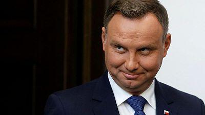 Poland signals seven judges must quit in court overhaul
