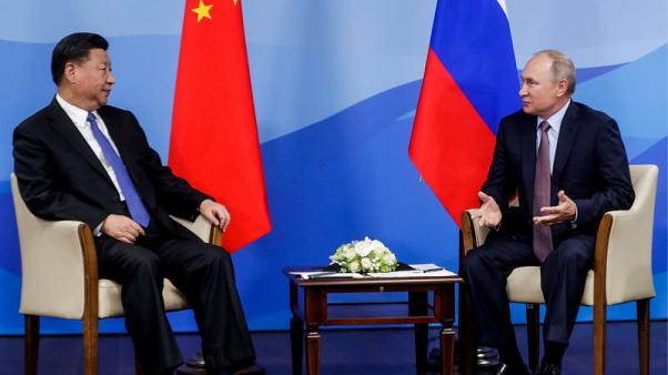 China's Xi calls for Moscow and Beijing to unite to fight protectionism