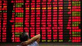 World stocks inch off 3-week lows but little respite for emerging markets