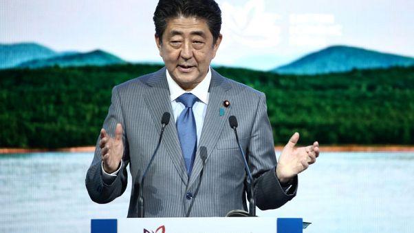 Japan's Abe says he wants to meet North Korean leader Kim