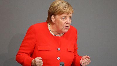 Merkel: No excuse for hunting people down, Nazi slogans