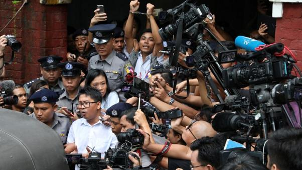 Myanmar group founded by prominent dissident urges release of Reuters reporters