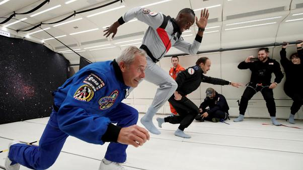 Usain Bolt toasts zero-gravity with champagne