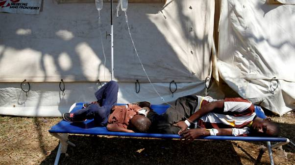 Zimbabwe police ban public gatherings in capital to contain cholera outbreak