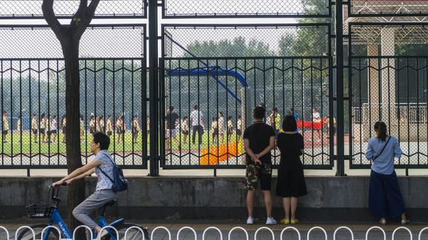 As Chinese school year starts, some Beijing residents find their kids can't get admission