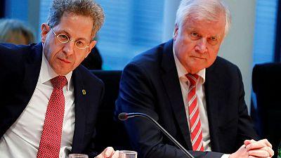 Divided German leaders to meet next week over spymaster's future