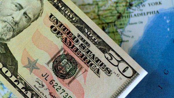 الدولار يهبط بعد بيانات التضخم وآمال بشأن التجارة الأمريكية الصينية