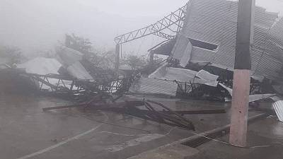 Three killed as Philippines warns of hazards in powerful typhoon's wake