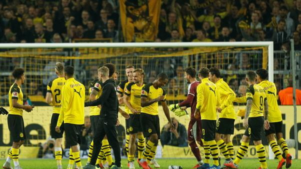 Dortmund beat Frankfurt 3-1 to go top in Bundesliga