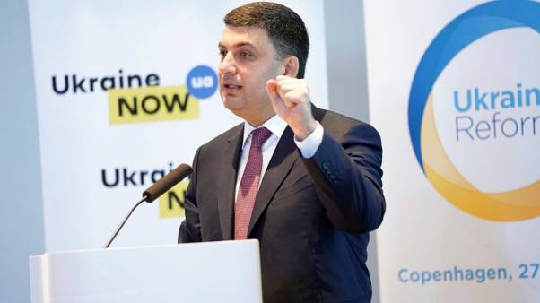 Ukraine PM says must fulfil commitments to IMF