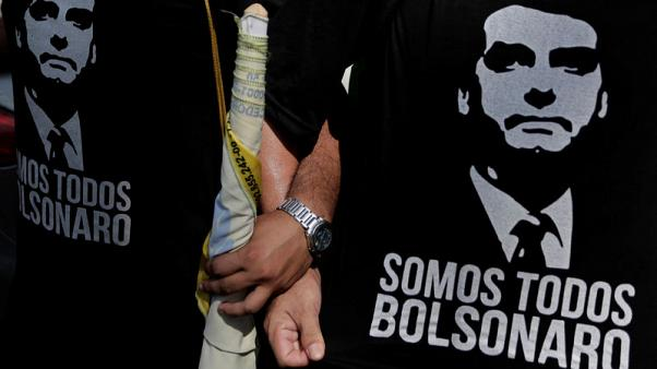 Brazil candidate Bolsonaro attacks Workers Party from hospital bed