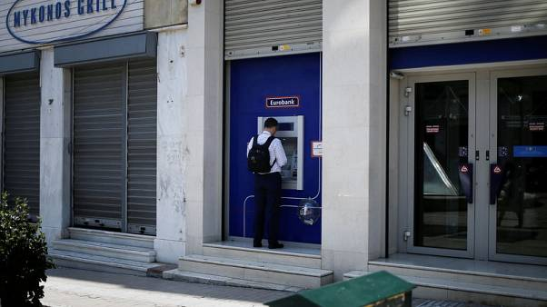 Exclusive - Eurobank CEO expects to beat bad debt reduction target