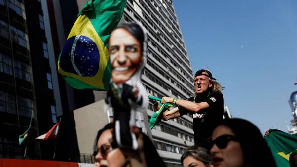 Brazil poll shows Bolsonaro leading with Lula stand-in Haddad second