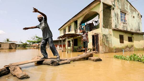 Nigeria's disasters agency says 100 people killed in floods across 10 states