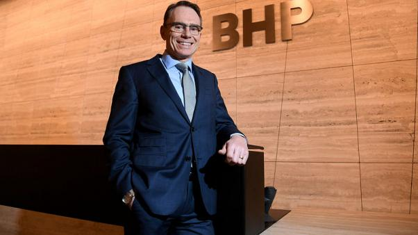BHP chief sees pay rise trimmed on production, fatalities