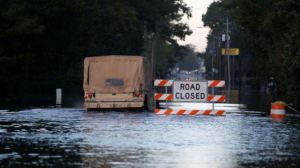 Rising flood waters from Florence menace Carolinas