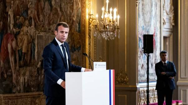 Macron injects more cash into France's strained healthcare system