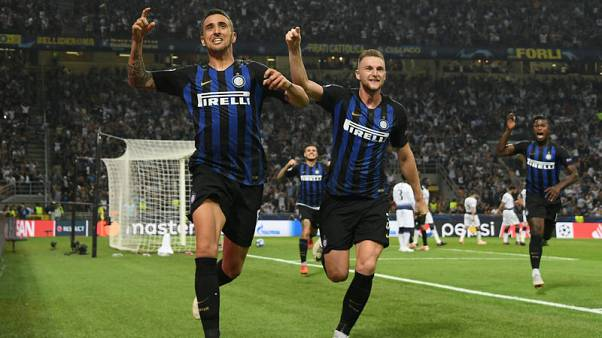Inter strike two late goals to sink Tottenham