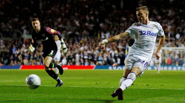 Leeds cruise past Preston to stay top