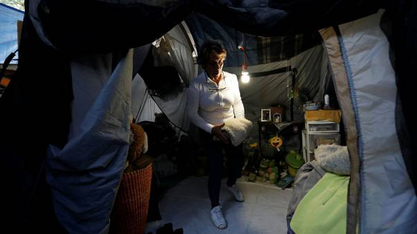 A year after deadly Mexico quake, some still wait to return home