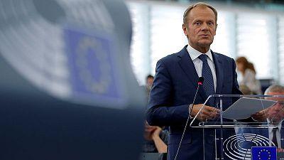 EU must end migration 'blame game' - Tusk