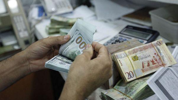 ليبيا تفرض رسوما على معاملات النقد الأجنبي لسد الفجوة مع السوق السوداء
