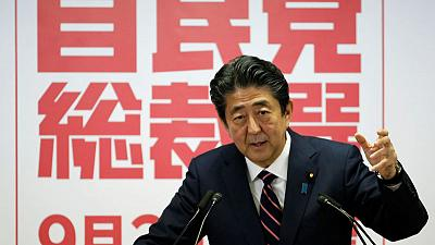 Japan PM Abe wins extended term, faces Trump trade challenge