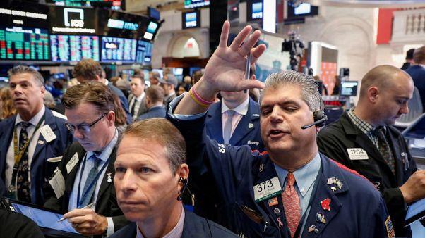 Stocks hit new highs as trade worries ease, dollar slips