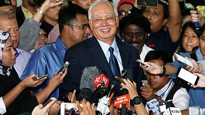 Former Malaysian PM charged with money laundering, abuse of power