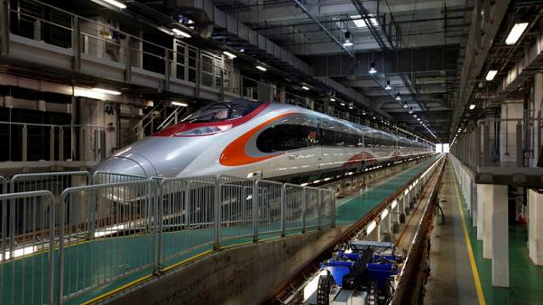 China tightens embrace of Hong Kong with bullet train, other mega projects