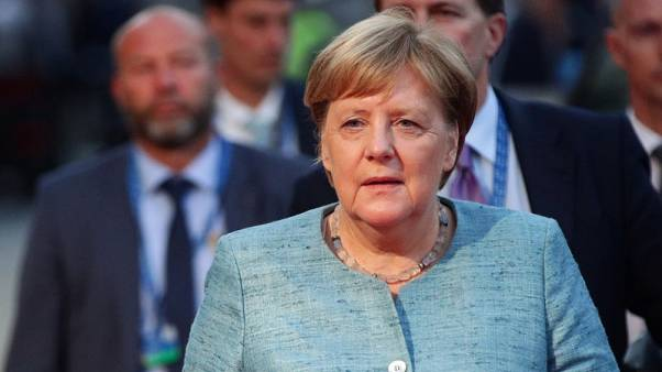 Spymaster row weakens Merkel, support for far-right climbs - poll