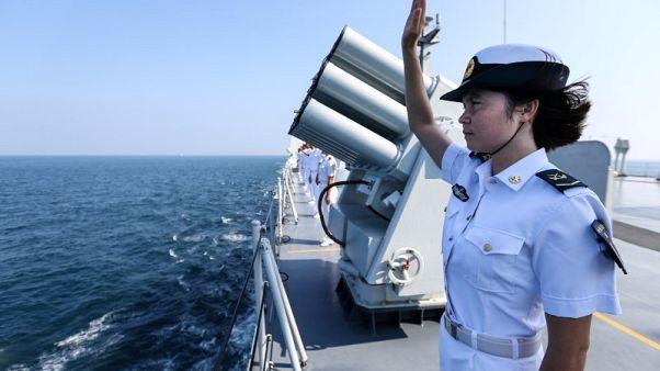الصين تحث أمريكا على رفع العقوبات عن جيشها