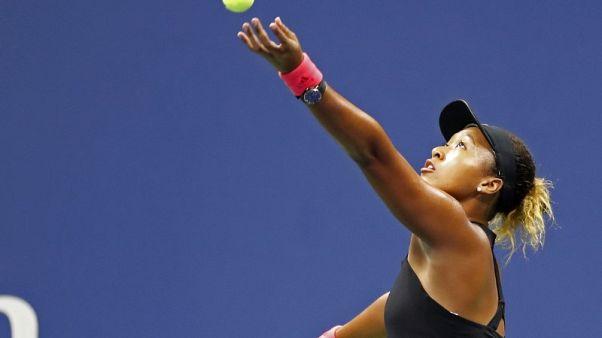 Tennis-Osaka eases into Tokyo semis