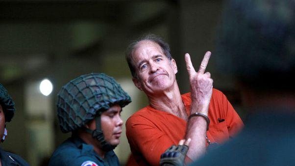 """أسرة مخرج استرالي أفرجت عنه كمبوديا تبدي سعادتها لانتهاء """"الكابوس"""""""