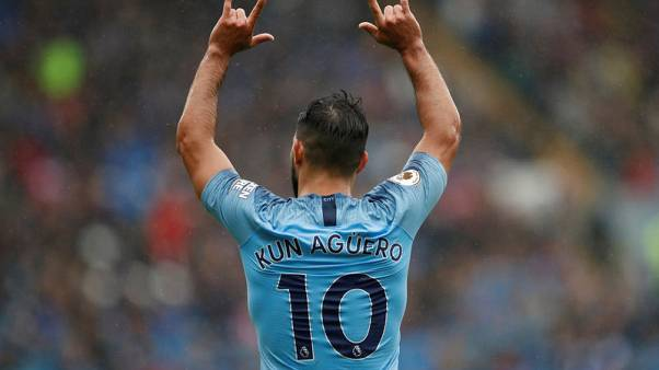Aguero scores in 300th game as City roar back to form