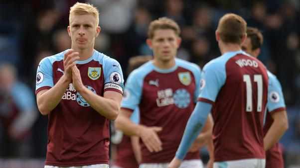 Burnley get first league win by thrashing Bournemouth