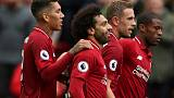 Liverpool, Man City stroll; United held on Fergie return