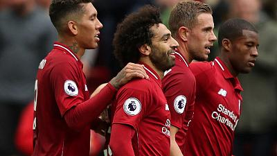 Liverpool, Man City stroll; United held on Fergie return