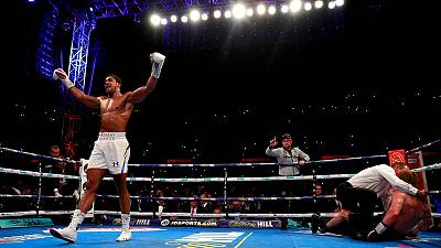 Boxing - Joshua retains heavyweight crowns with Povetkin TKO