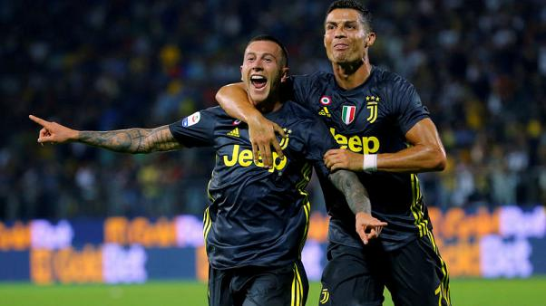 Juventus maintain perfect start but Roma lose at Bologna