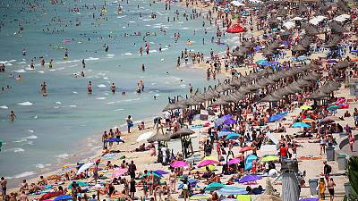 Thomas Cook warns on profit as hot summer hits demand