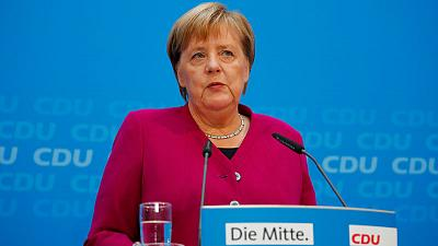 Germany's Merkel says regrets spymaster scandal