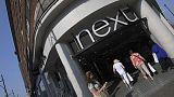 Next raises full-year profit guidance