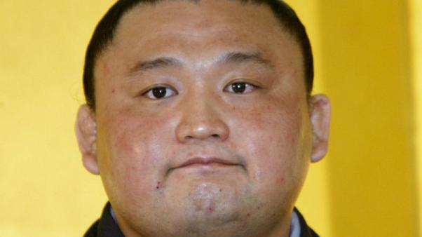 Former top-ranked sumo wrestler resigns following scandal