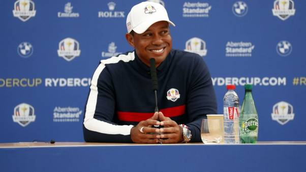 A taste of his Sunday best whets Woods' appetite for battle