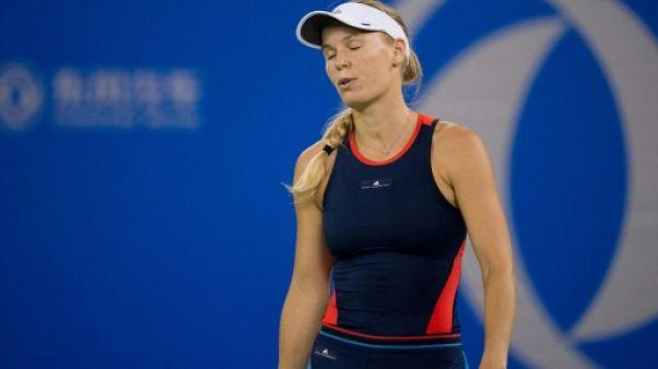 Tennis: Wozniacki sortie, l'hécatombe continue à Wuhan