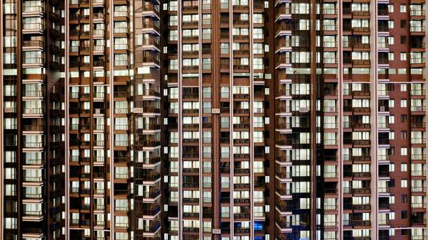 Hong Kong property firms scramble to lure buyers as rate hikes loom
