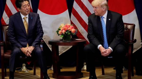 Trump says Japan's Abe agrees to start talks on free trade deal