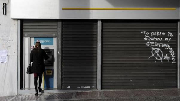 Greece eases capital controls, ends restrictions on cash withdrawals